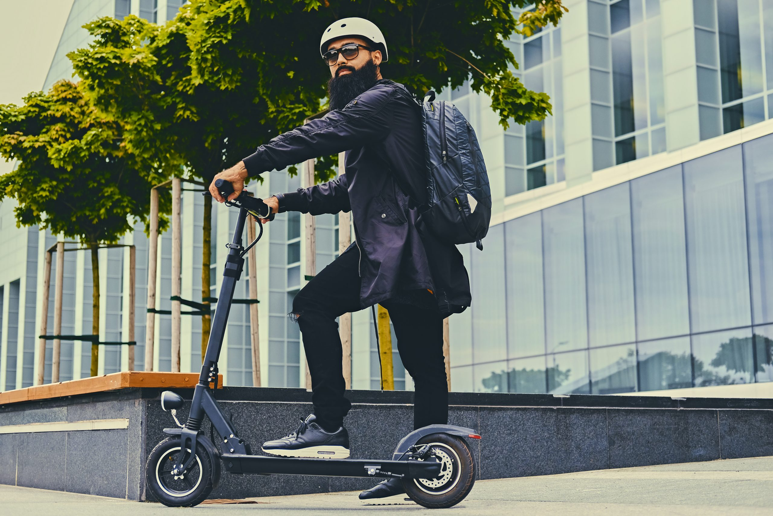 A Man Posing On Electric Scooter.